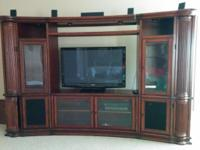 1)Entertainment center with pull out storage for