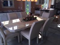 Marble Dining table and 6 leather chairs. Great