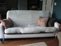 off-white, super nice, wooden-legged futon. removable