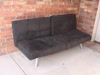 Futon is in perfect condition, very lightly used. Comes