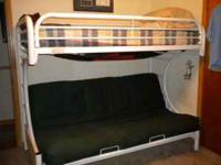 Bunk bed is white and all metal. The upper mattress is