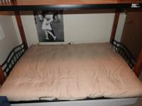 Has a futon couch on the bottom and space for a bed on