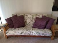 Pier 1 Wooden Futon sofa for sale. Converts to a full