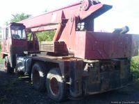 THIS IS A TANDEM AXLE 1973 FWD TRUCK MOUNTED HYDRAULIC
