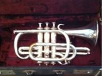 I'm selling my cousins coronet/trumpet who used to play