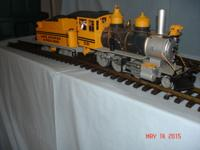 One LGB Locomotive and coal car, one Bachman Locamotive