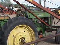 G John Deere tractor and loader will separate. Call