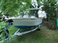 1982 model year boat with a rite galvanized trailer. 85