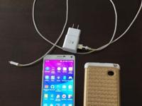 Good condition Unlocked Gold case and charger included