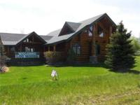 Beautiful Bear Creek model log home currently used as