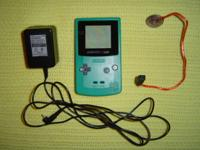 Teal Game Boy Color + OEM AC adapter + LED wormlight -