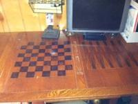 Old vintage gaming table with a checker/chess board and