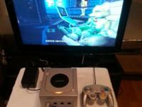 I have a Game Cube game system with 1 Controller and 5