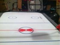 A full size air hockey table that is 8' x 4' & keeps up