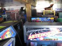 Full sized video arcade machines, pinball games, touch