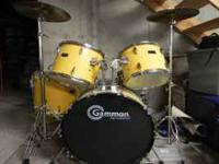 6 piece drum set with stool, yellow, set is 3 years