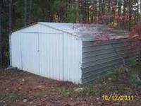 Metal Garage or Storage Building. Totally enclosed.