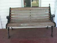 Vintage wood bench with ornate metail deails on legs