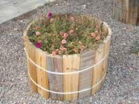 Recycled materials used to build these fun planters.