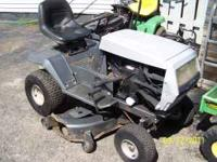 White garden tractor, riding mower. Has 16 hp briggs