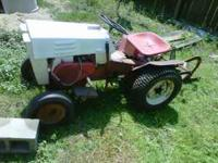 Old garden tractor runs and has plow needs battery $600
