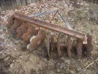 Garden tractor disc harrow might be from a planet