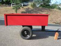 Garden trailer that can be towed behind tractor or