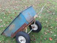 All metal garden dump trailer 20w X 37l X 11d. Rock