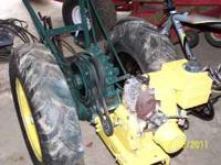 wheelhorse plow, has single turning plow attached, 2