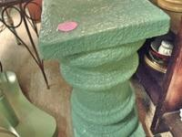 Teal painted heavy pedestal can be used as a garden