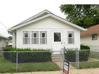 Well-maintained home in Garfield Park area. Totally