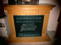 GAS FIREPLACE NEW NEVER USED, HAS REMOTE AND