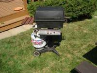 propane gas grill. electronic light. two knobs. tank