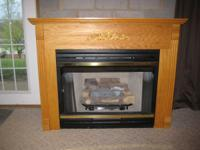 VENTLESS GAS FIREPLACE with beautiful Oak Hearth.