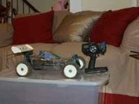 Two Gas Powered rc cars. These cars come with extra