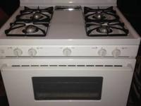 4 burner white gas range for sale.  Bought in Home