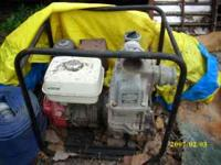 Gas water pump for ponds or other. Flooded areas. Works
