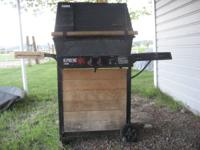 Gas BBQ with cover and propane tank! Call Holly to view