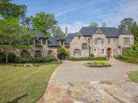 Located near Chastain Park this gated brick andnstone
