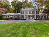 This gated 4.4+/- acre hilltop estate with a heated