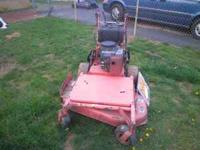 Up for sale is a gravely wlk behind mower. Mower runs