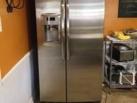 GE Adora side-by-side stainless-steel 25 cu ft fridge.