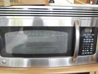GE Microwave connects over the stove.Like new.Also have