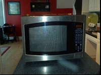 This is a good large microwave. Clean and works