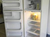 This GE refrigerator is almond color and mint cond. no