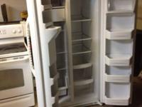 FOR SALE. GE Side-by-Side refrigerator with ice and