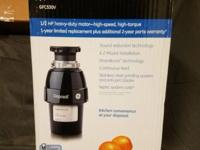 Never opened, brand new GE food disposal for your