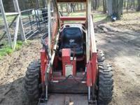 "Gehl 2600 Skidsteer, 54"" bucket and round bale spear,"