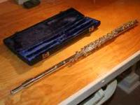 Nice sounding flute, paid $1300 14 years ago. Not used
