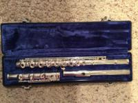 Like new condition flute with solid silver head and
